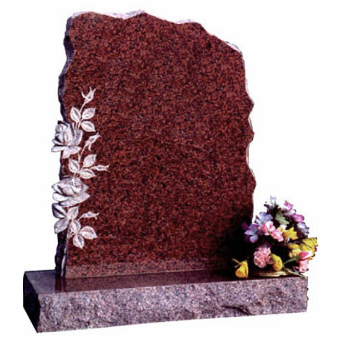 A random shaped and rustic pitched memorial with 3d carved roses